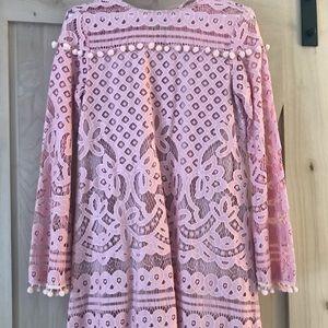 Trendy pink babydoll dress with pom poms